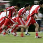 Chinese soccer players sprint during their training session for the upcoming AFC Asian Cup soccer tournament in Kuala Lumpur