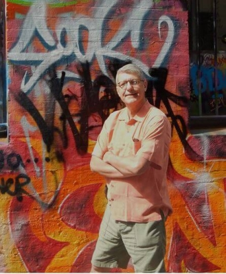 john-with-graffitti-in-the-background