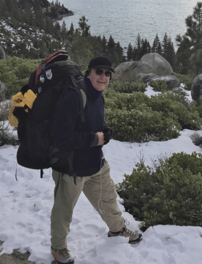 JOHN HIKING IN SNOW