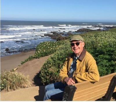 John on a Beach Bench