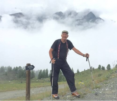 john-wearing-suspenders-hiking-with-fog-in-the-background